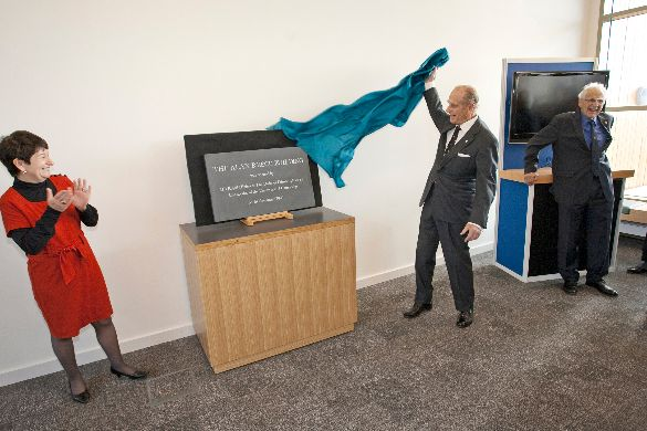 19 November 2009: the Duke of Edinburgh unveils the plaque at the opening of the new building, applauded by Dame Alison Richard, the Vice- Chancellor of the University of Cambridge at the time.
